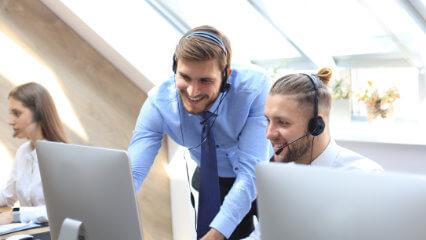 A Team Leader providing feedback to a call centre agent